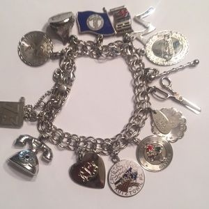 Jewelry - Vintage Sterling charm bracelet full of charms